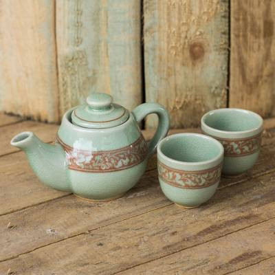 green crackled teapot and 2 tea cups with brown filigree