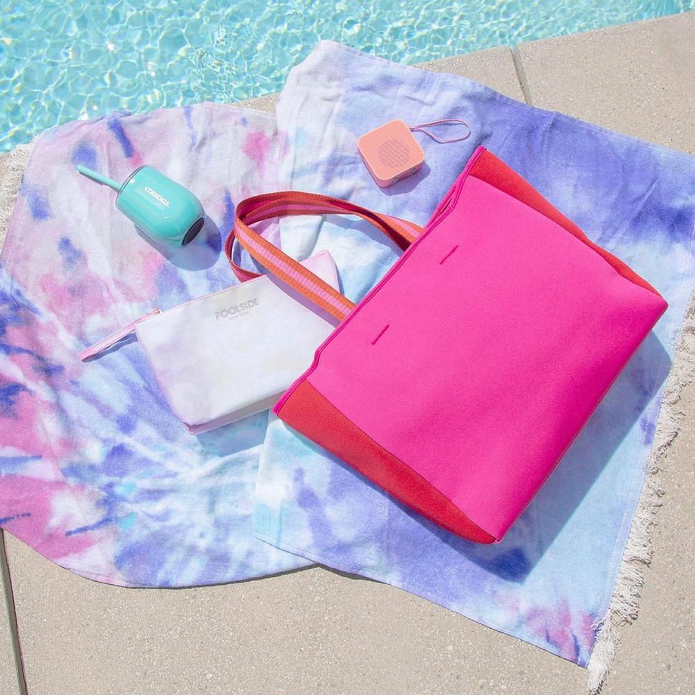 pool towels and pink bag by the pool fabfitfun box