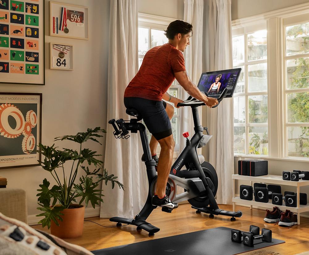 man on peloton exercise bike fitness