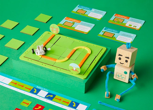 green STEM toy with robot and instructions