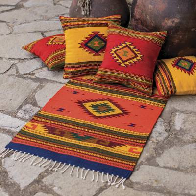 colorful yellow red and green Zapotec rug and throw pillows
