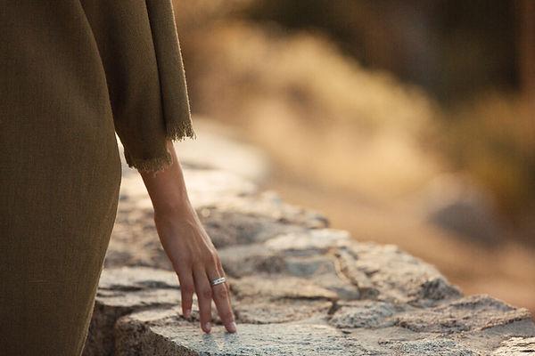 Girl hand on rock.jpg