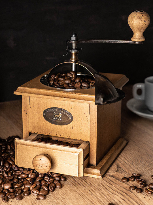 antique wood coffee grinder with coffee beans