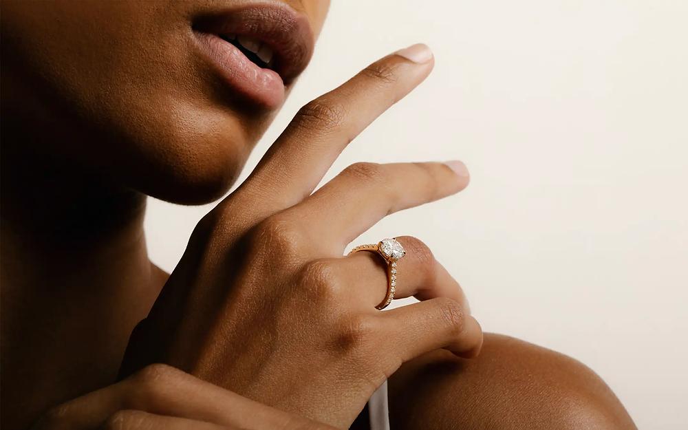 woman wearing round cut engagement ring