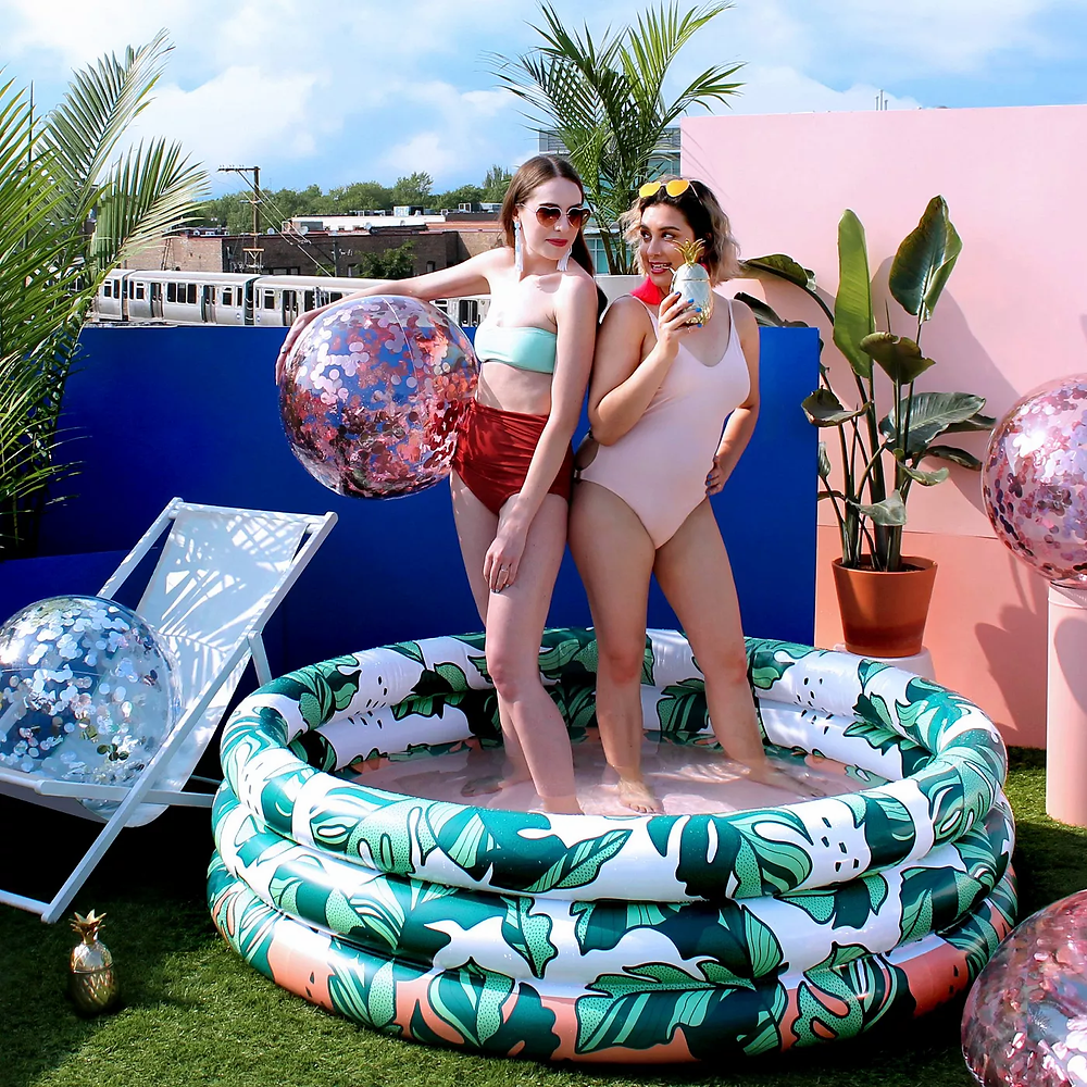 adult inflatable pool with banana leaves