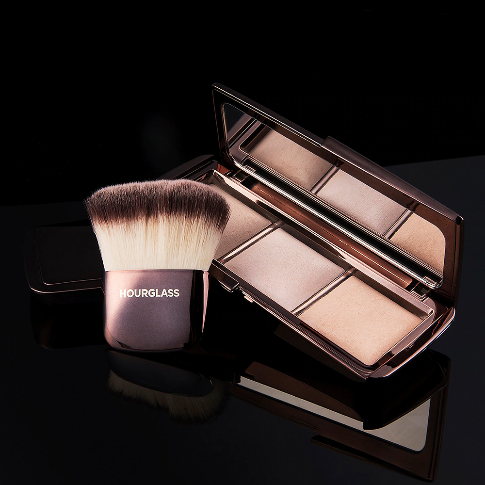 Hourglass ambient lighting palette with brush on dark background