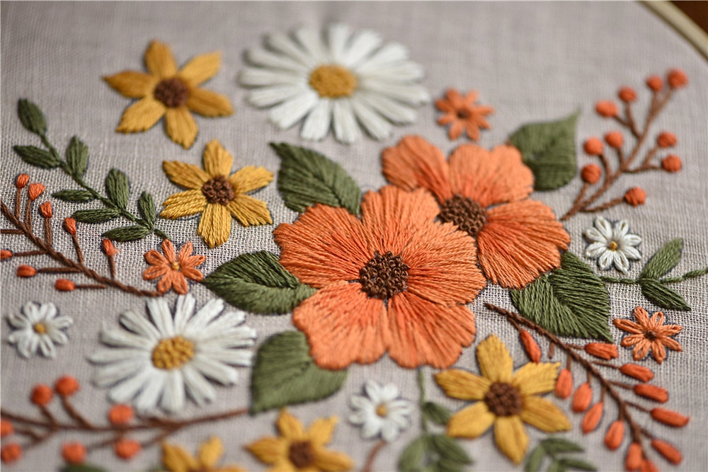 floral embroidery kit with grey muslin orange and yellow flowers green leaves