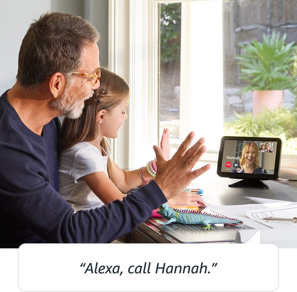 father and daughter wave to woman on echo show screen
