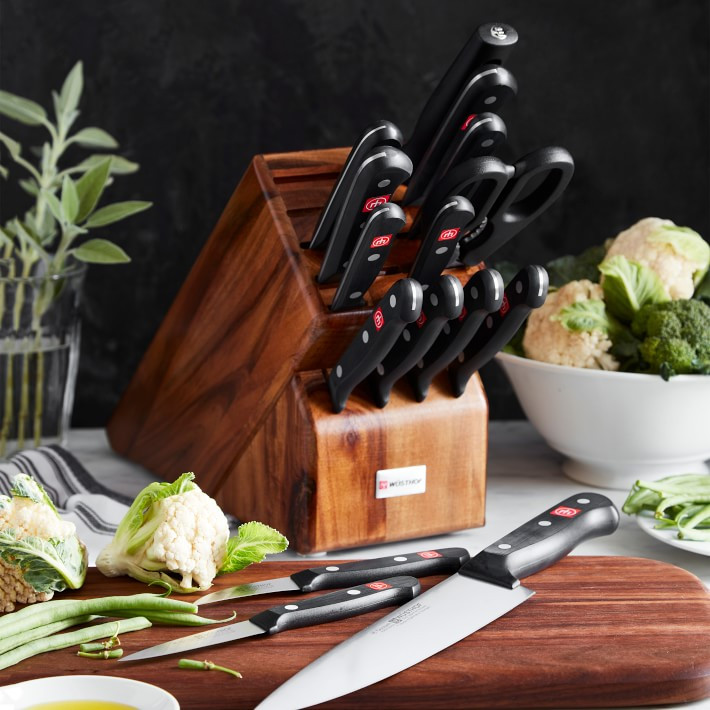 Wusthof 16 piece knife set in a block on a table with cauliflower