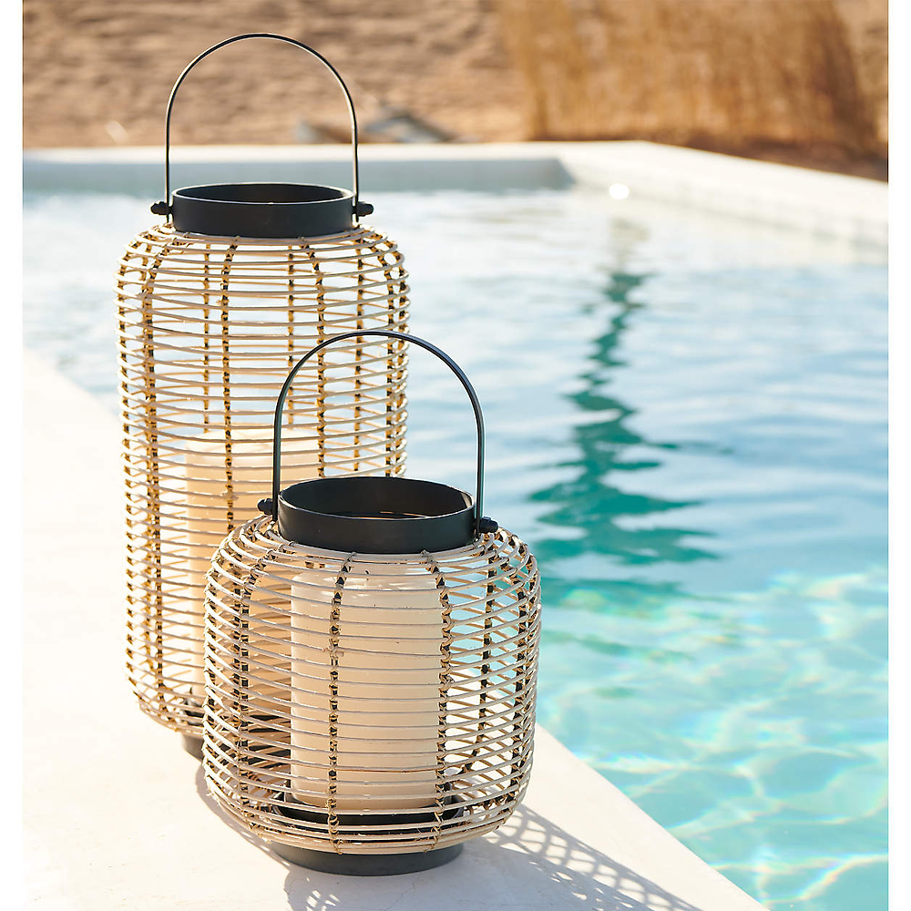 two rattan lanterns at the poolside