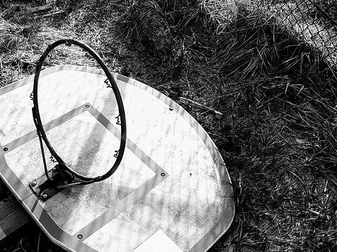 old basketball hoop on ground