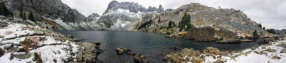 pano of snow capped mountains and lake