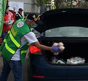 Volunteer Placing Food.JPG