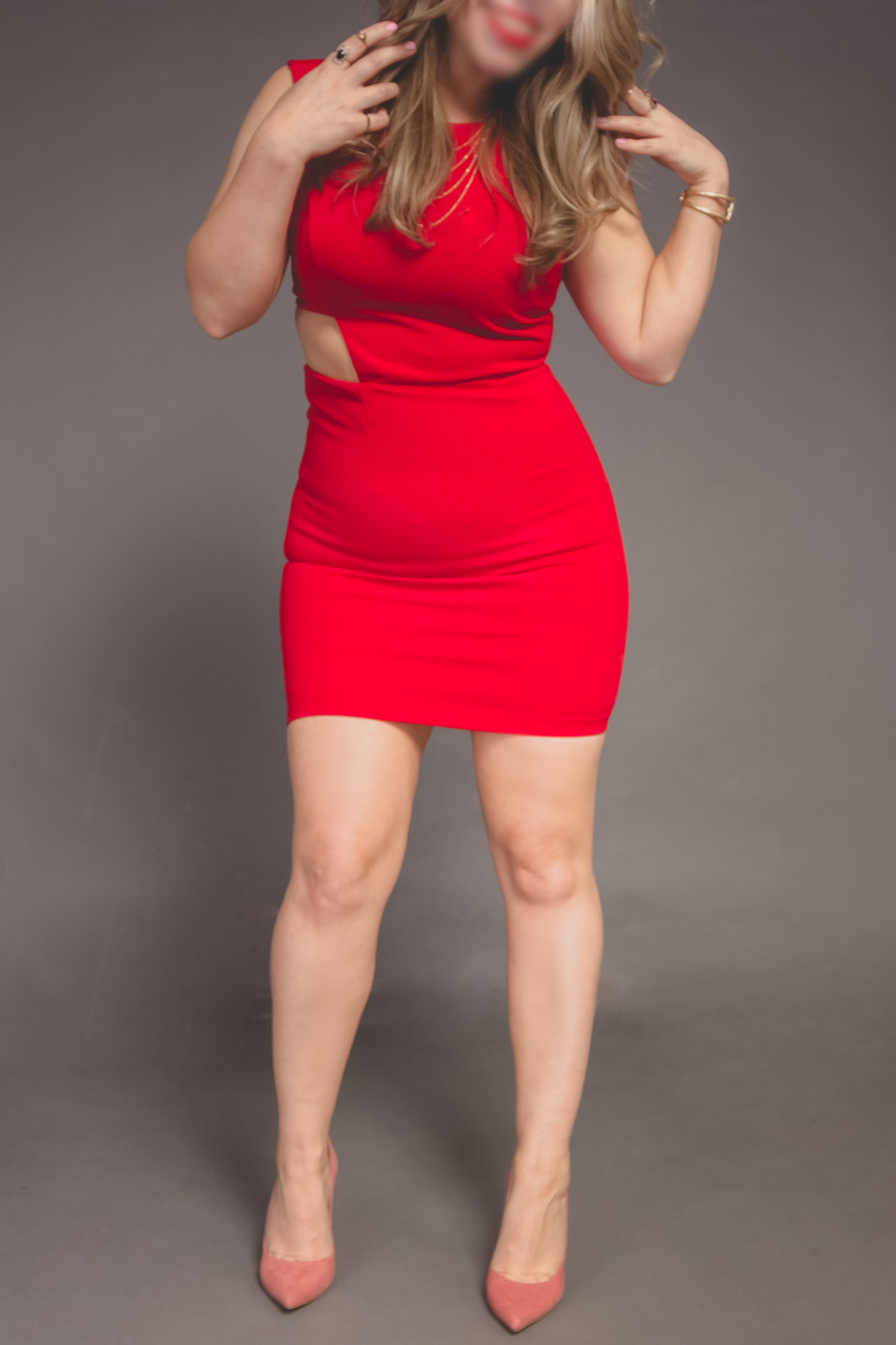 Curvy Blonde in a Tight Red Dress
