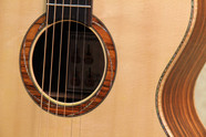 Carpathian spruce soundboard, abalone purfling and curly maple binding