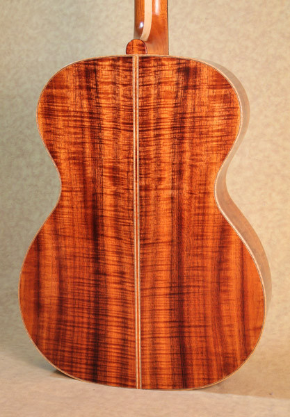 Curly Koa guitar body with curly maple binding