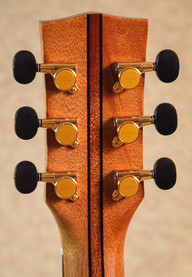 OM guitar headstock with five piece neck