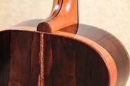 Malaysian Blackwood OM guitar, abalone backstrip and koa binding
