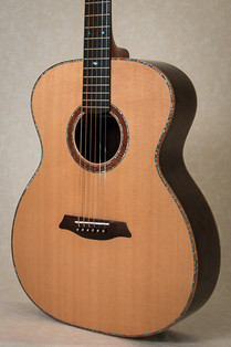 OM guitar with Sitka spruce top, curly koa binding and abalone purfling