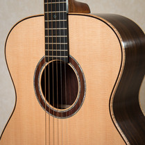 OM guitar with Sitka spruce top and curly maple binding