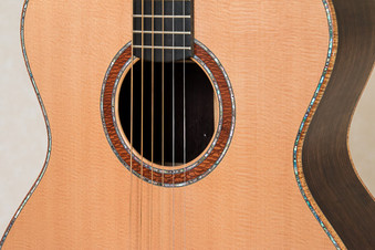 Rosewood OM Guitars body with abalone purfling