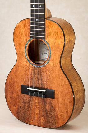 Curly koa tenor ukulele with Macassar ebony binding