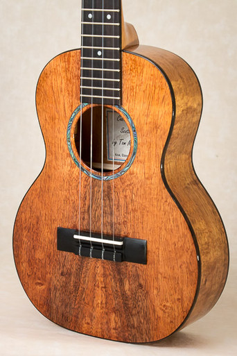 Curly koa tenor ukulele with Macassar ebony binding