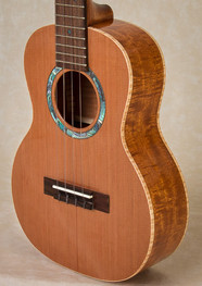 Curly mahogany and cedar ukulele with curly maple binding
