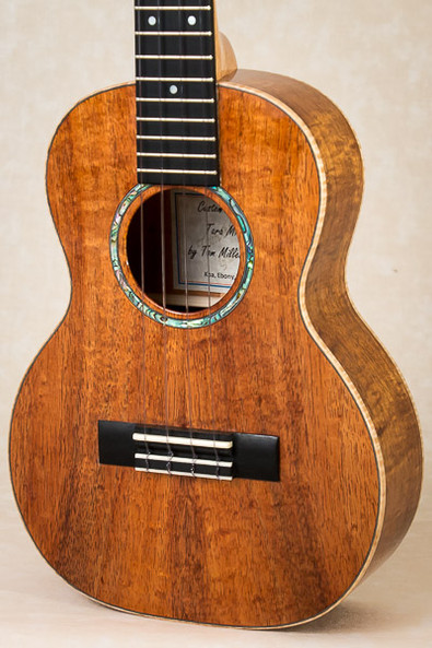 Curly koa tenor ukulele with curly maple binding