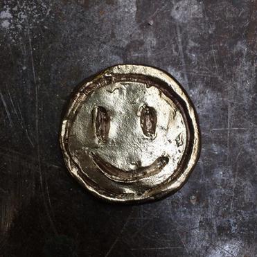 'smiley coin'