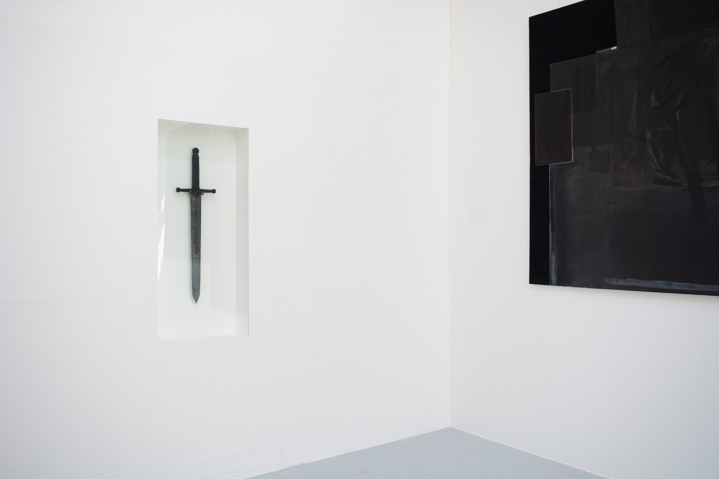 Installation shot of 'Kneeling before icons' and 'saint'