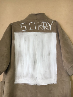 'sorry' coat, hung on the studio wall