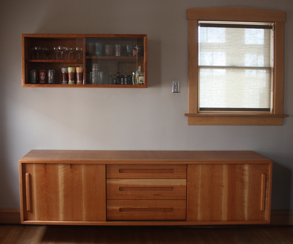 Floating buffet/sideboard with glass storage