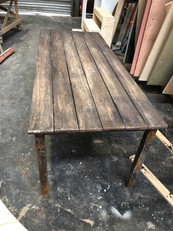 Faux rusty wooden table for theatre show  Built at Liverpool Scenic Workshops