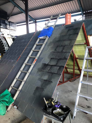 Fibreglass slate effect tiles being painted