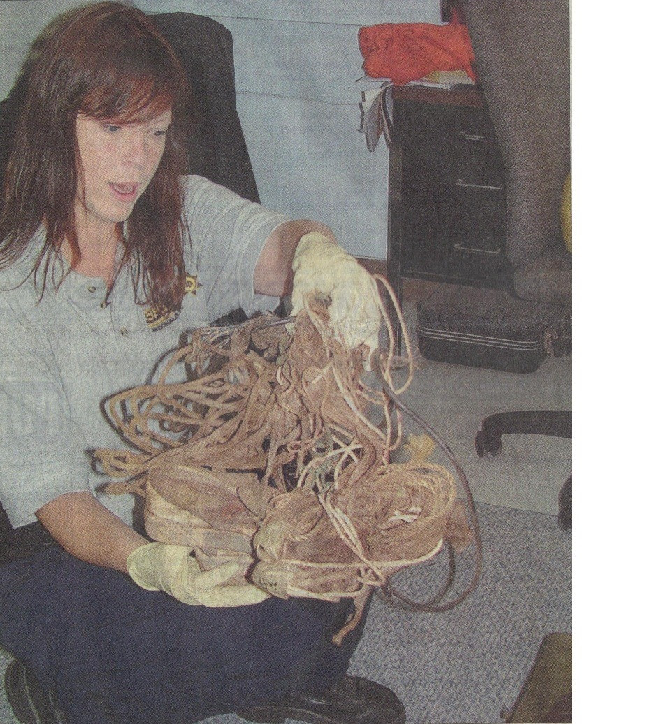Detective Lorie Howard with the bindings used on Grace Doe. Photo courtesy of Crimesceneinvestigations.blogspot.com