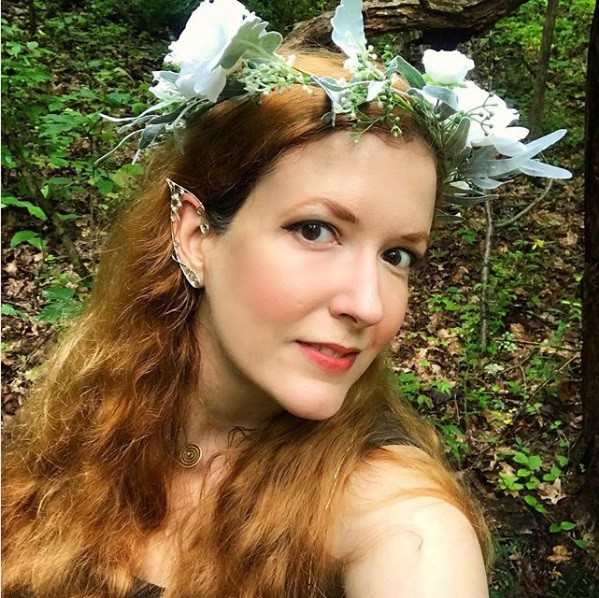 Beautiful fairy ready for a stroll through the woods