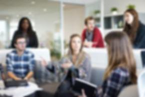 people in office meeting discussion with girl boss women in business UK. Kilomtre Zero office in Edinburgh.