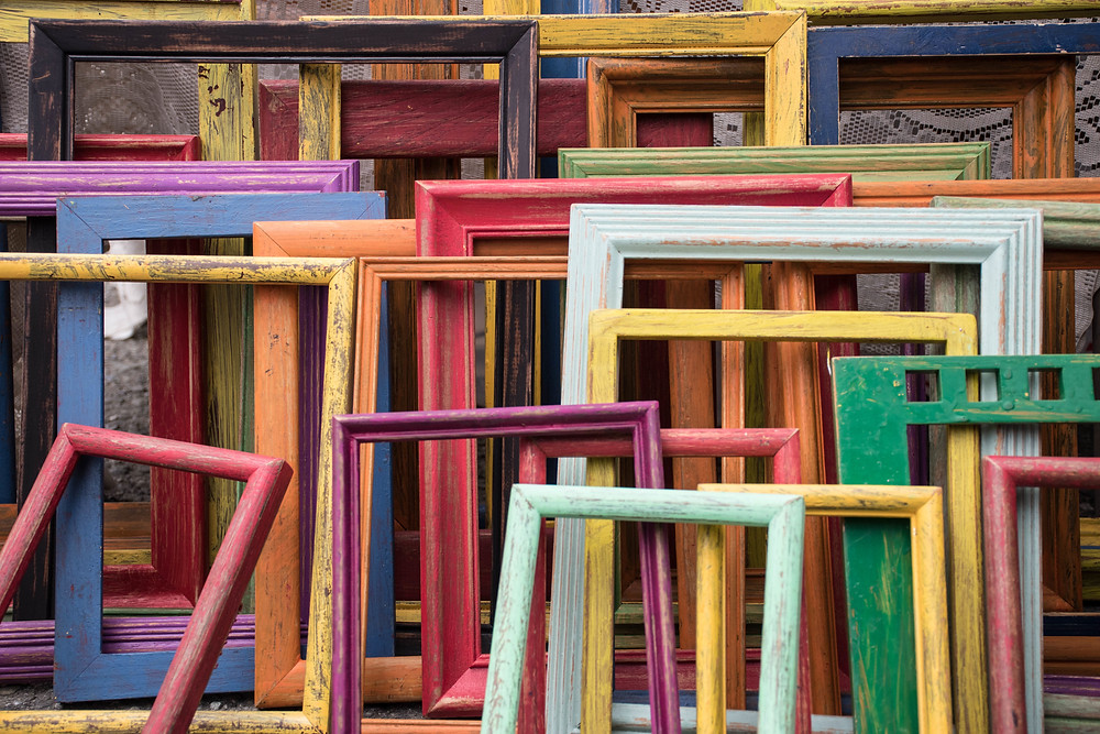 Today's Treasures - Today's Treasures: What People Want to Buy from Estates: multiple empty colored picture frames stacked against one another