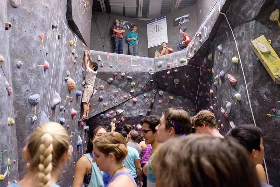 A crowded climbing gym.
