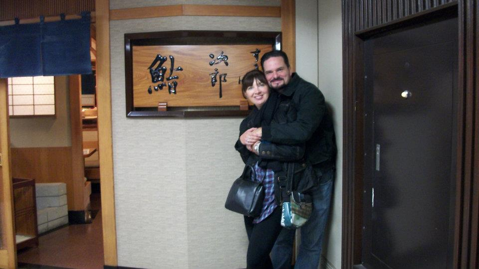 Two members in front of Sukiyabashi Jiro