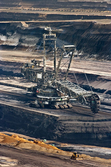 silver-steel-mining-crane-on-black-rocky