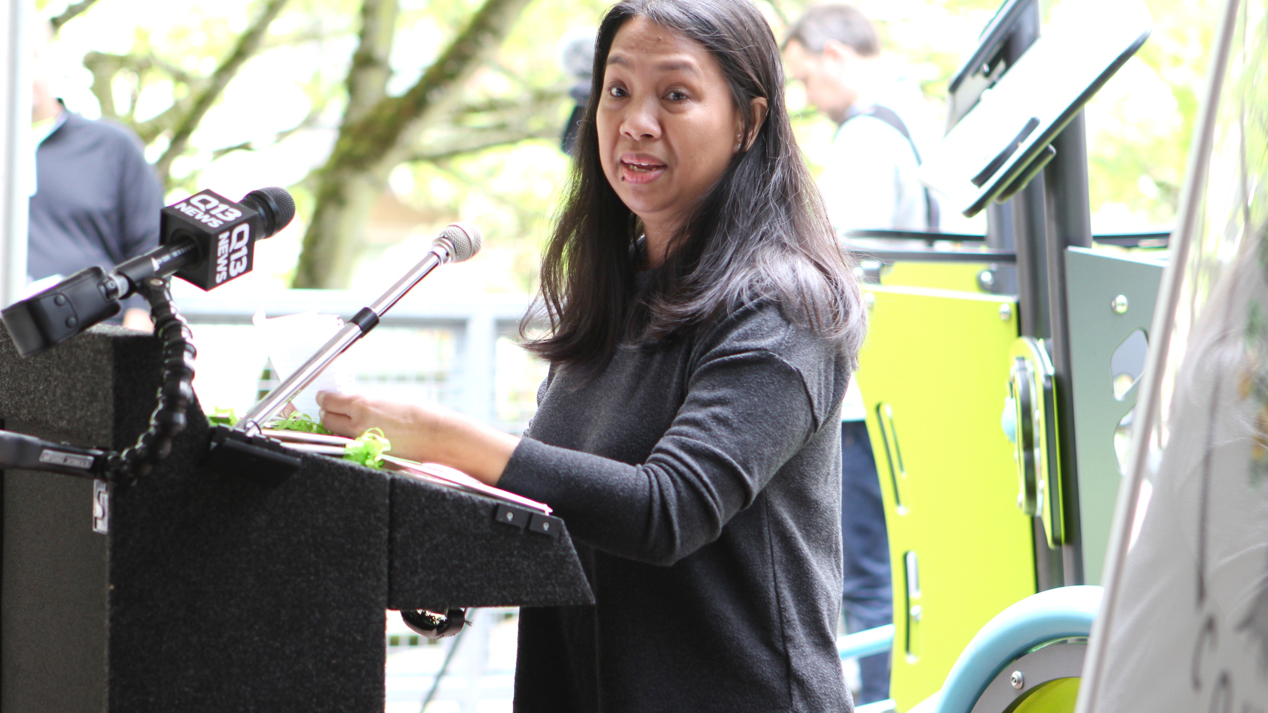 Elizabeth Soriano, a resident of Bellwether's Bellevue Olive Apartments, speaks at the opening celebration of Arbora Court.