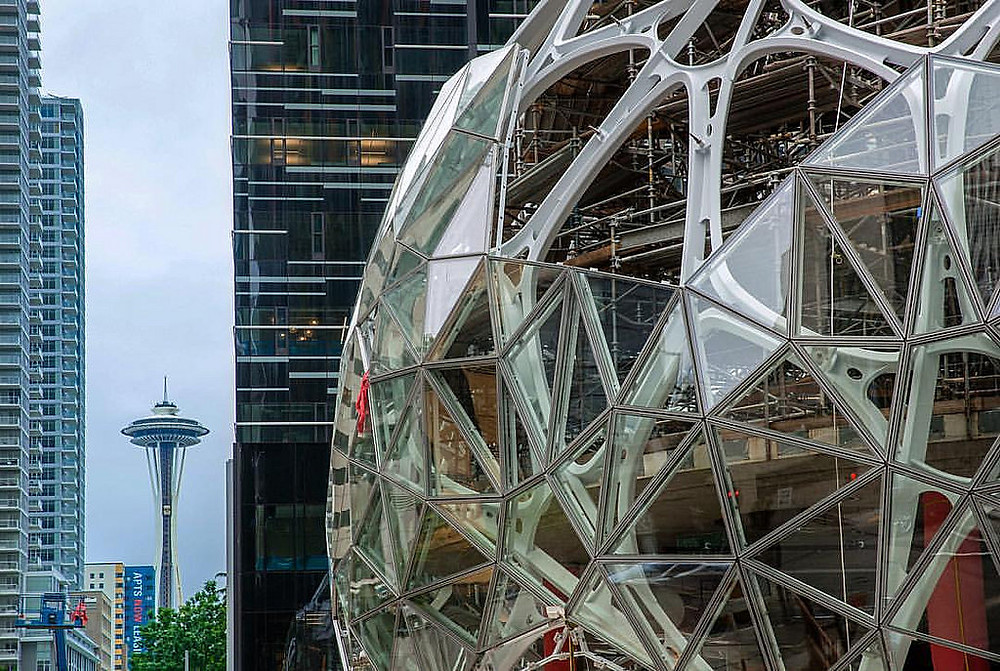 The Space Needle is visible between the new Amazon sphere and office building and new condos in Belltown
