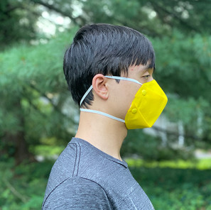 A Model Wearing an Early Iteration of Oricool Facemask Prototype