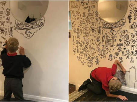 Niño de 9 años que era castigado por dibujar en clases consigue trabajo para decorar un restaurant