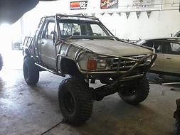 Straight Axle Conversion and Custom Exocage Roll Cage done on a 2nt Gen Toyota Pickup Truck at Flex Point Off Road in Redding California