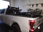 Custom built rear bed rack on a Ford Superduty Truck built at Flex Point Off Road in Redding California
