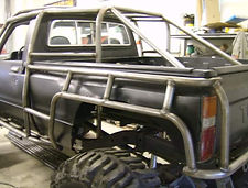Custom Roll Cage on a 1st Gen Toyota Pickup Truck built by Flex Point Off Road in Redding California