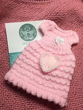 picture of a crochet gown with a matching crochet heart and a leaflet
